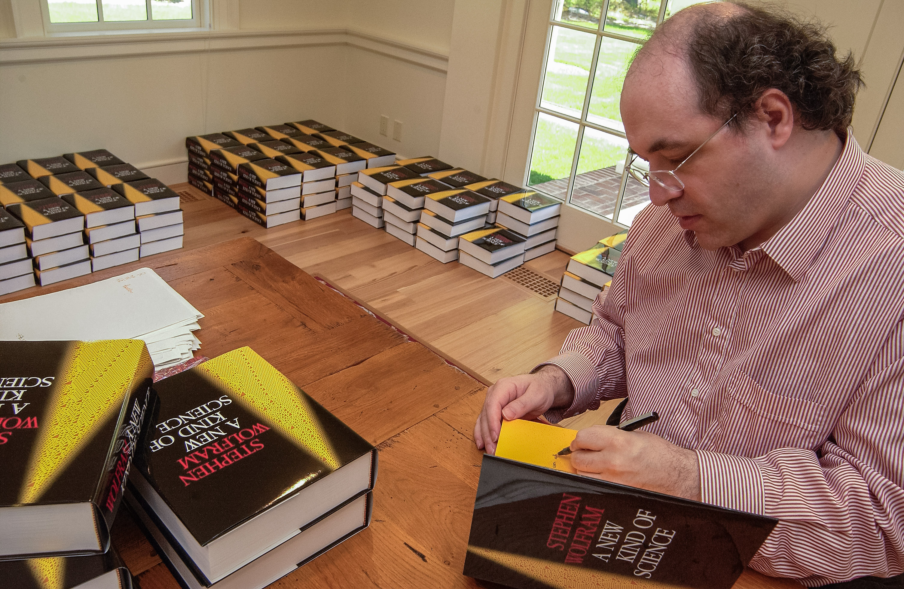 The life and times of Stephen Wolfram. 2002: Signing NKSes for friends and employees...
