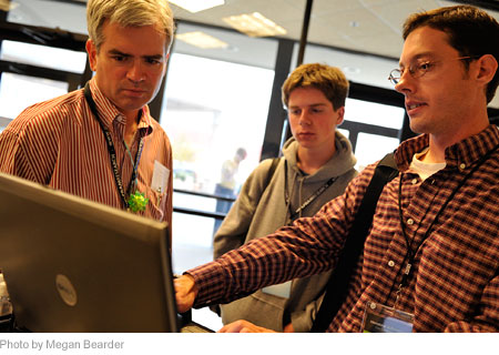 A Wolfram employee working with conference attendees during break