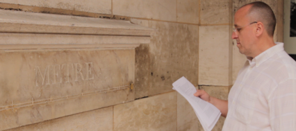 German tourist studying the history of one of the few remaining mètres étalons