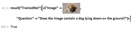 Does the image contain a dog lying down on the ground?